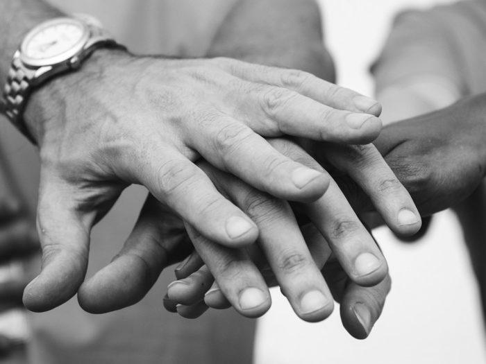 Teambuilding - handen op elkaar